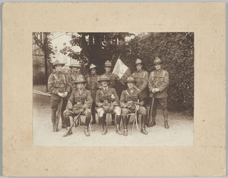 The Fanion Presentation Party consisting of representatives of the New Zealand Cyclists Battalion, 28 July 1919, maker unknown. Te Papa (CA000316/002/0001)